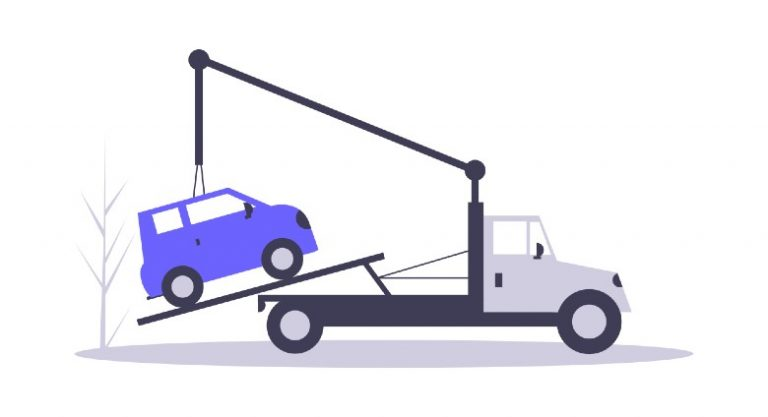 Car being towed by truck