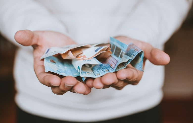 Man holding cash in his hands
