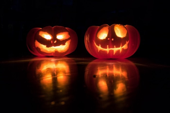 carved pumpkins with candles inside